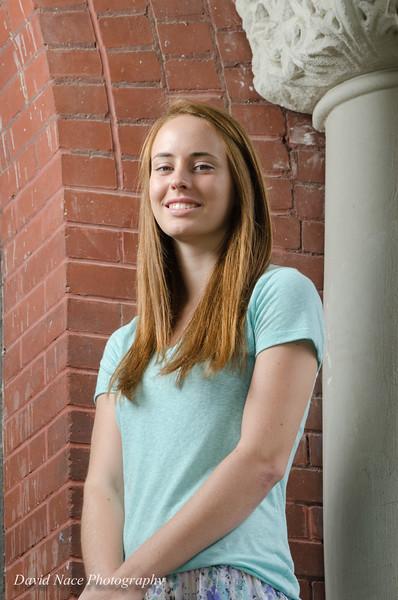 Lauren by front entrance columns-86