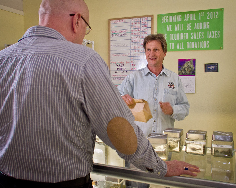 Lawrence Pebbles gives some Marijuana to a patient at his medical marijuana dispensary in Novato, Calif. on April 26th, 2012.