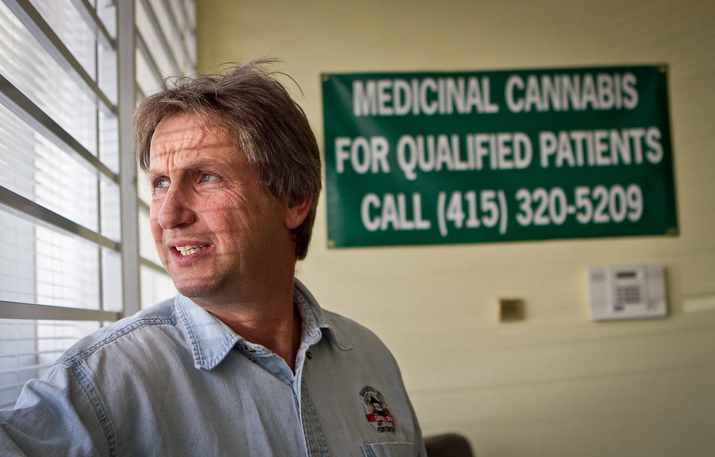 Lawrence Pebbles looks at the window of his medical marijuana dispensary in Novato, Calif. on April 26th, 2012.