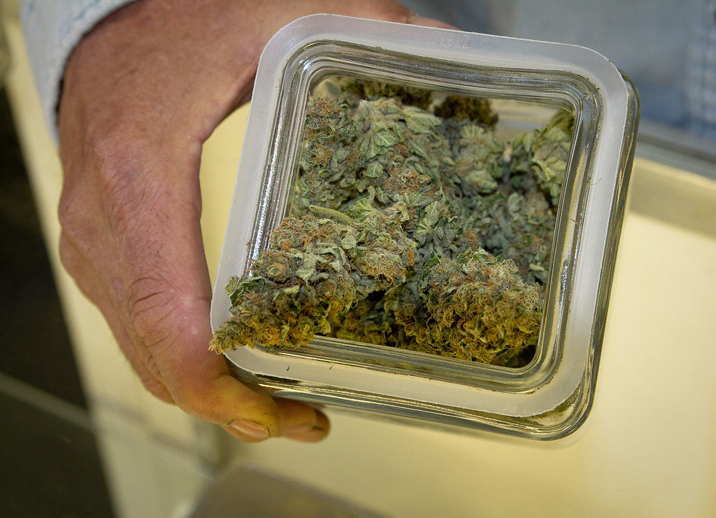 Lawrence Pebbles shows some Marijuana Buds in his medical marijuana dispensary in Novato, Calif. on April 26th, 2012.