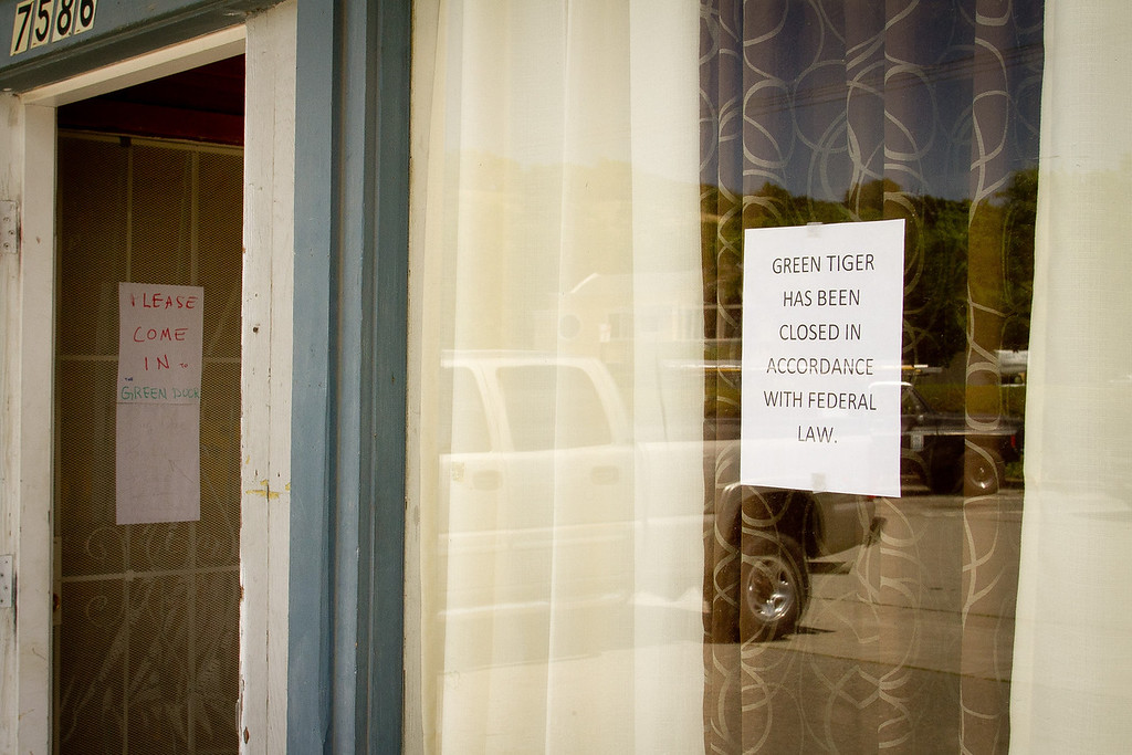 The sign in the window of the closed dispensary next to the Green Door medical marijuana dispensary in Novato, Calif. on April 26th, 2012.