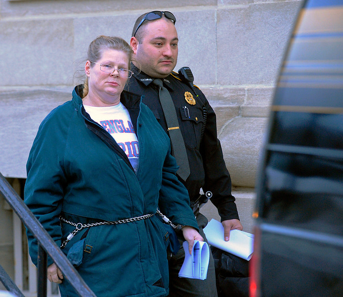 Leanna Wilson, a Fitchburg mother accused of beating her 6-year-old daughter and fleeing to North Carolina with her last month, is led out from Fitchburg District Court after she was arraigned earlier on Friday. Wilson was held on $22,000 cash bail.<br /> SENTINEL & ENTERPRISE / BRETT CRAWFORD