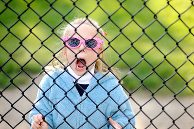 Fence reflected in the sunglasses.