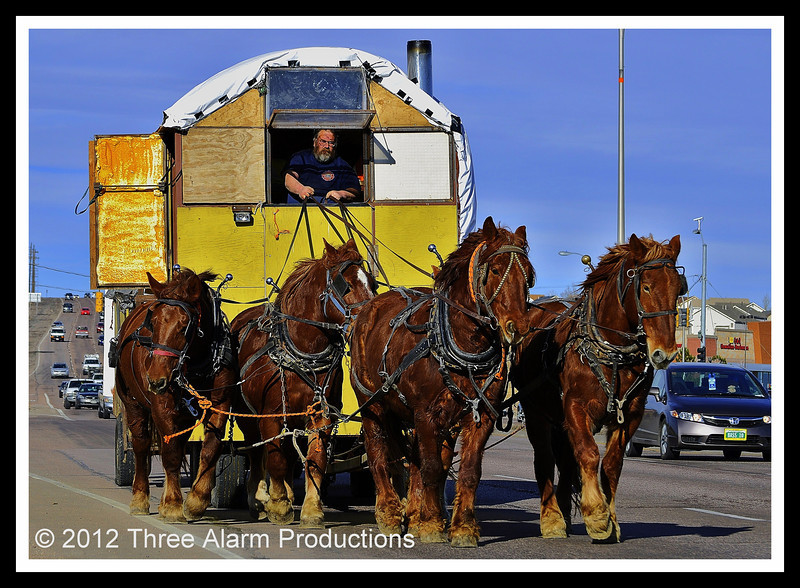 """""""Lee the Horse Logger"""" is the man who travels the highways of the United States with his team of horses pulling his home."""