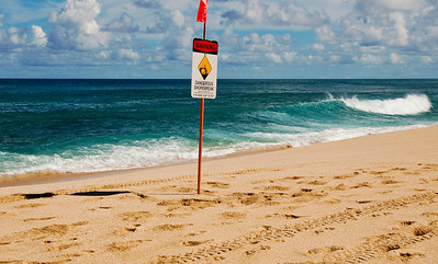 Warning signs on Ehukai Beach