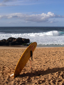 Lifeguard's Yellow Rescue Surfboard in the sand at Rockpiles