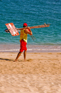 Lifeguard at Sunset Beach putting up warning signs, September, 2004