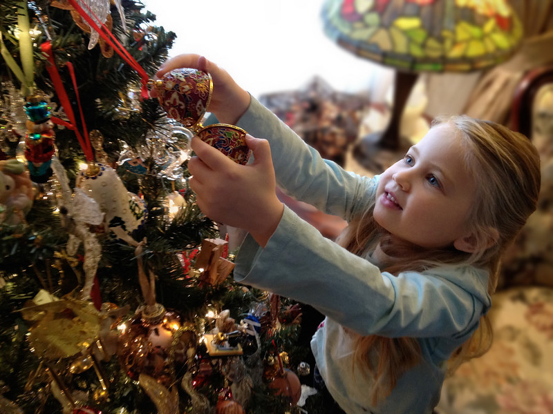 Little girl excitement at Christmas tree