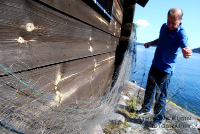 Cleaning fish lines - Archipelago, Sweden