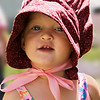 Portrait of little girl in 'pioneer' bonnet