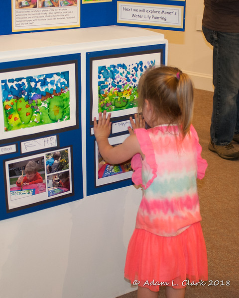 Liliana looking at her Monet painting