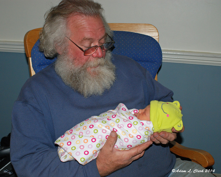 Grandpa holds her for the first time