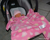 Asleep in her car seat after a trip out and about.  She takes up so little of the car seat