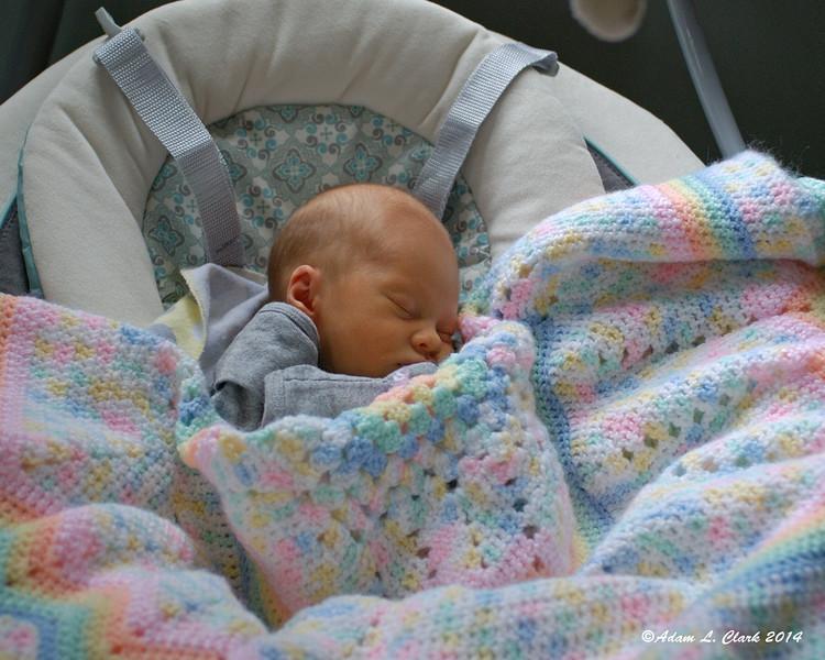 Asleep under a blanket in her swinging chair