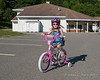 2018.06.11<br> Riding her bike in the school parking lot