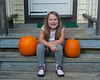 2020.10.06<br> Liliana on the steps with her and her sister's pumpkins