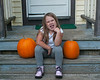 2020.10.06<br> Liliana on the steps with her and her sister's pumpkins, while making a goofy face