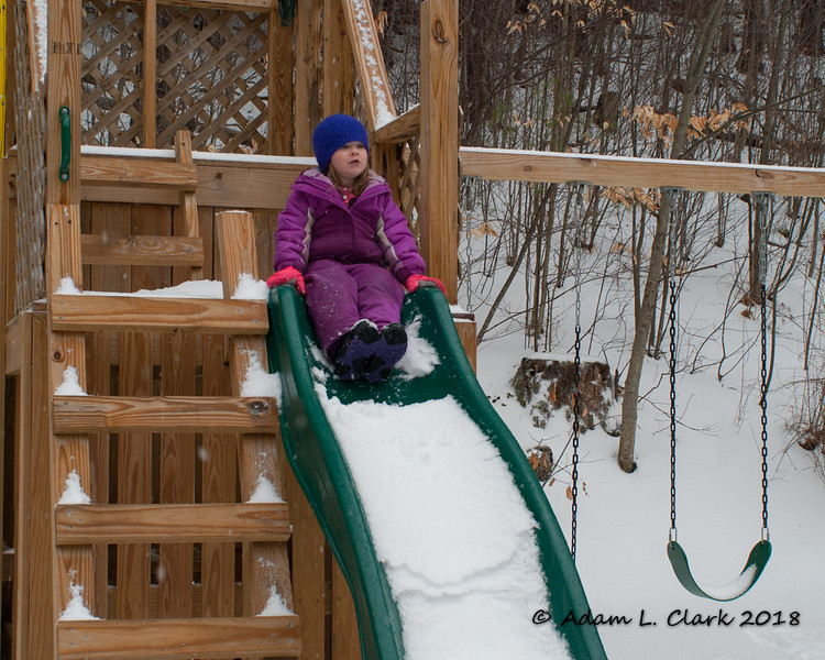 Getting ready to go down the snow covered slide
