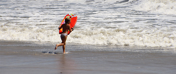 Atlantic City during Hurricane Earl...Little surfer girl!