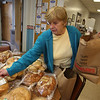 Littleton Meals on Wheels volunteer Jane Lyons gets ready to leave on a delivery run, at the Council on Aging. Besides hot lunches, she had bread deliveries to make, and was trying to guess what kind people would like. The bread was donated by Donelan's.  (SUN/Julia Malakie)