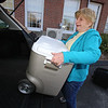 Littleton Meals on Wheels volunteer Jane Lyons loads hot lunches into her car for a delivery run, at the Council on Aging.  (SUN/Julia Malakie)