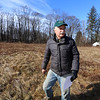 Volunteer Rick Findlay of Littleton, at Prouty Woods. He's involved with the New England Forestry Foundation, open space preservation, and fighting invasive species.(SUN/Julia Malakie)