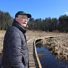 Volunteer Rick Findlay of Littleton, on the recently built Cloverdale Boardwalk. He's involved with the New England Forestry Foundation, open space preservation, and fighting invasive species.(SUN/Julia Malakie)