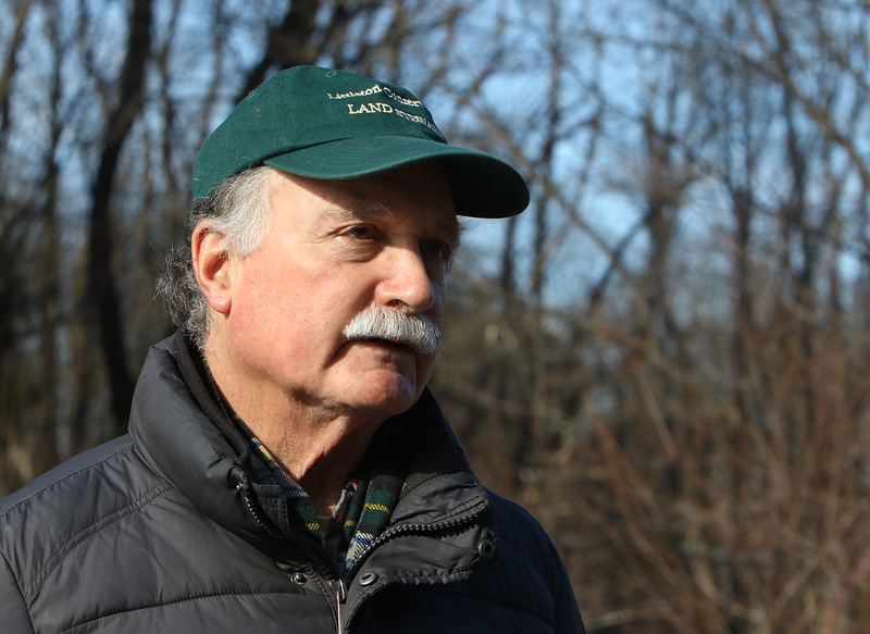 Volunteer Rick Findlay of Littleton, at Prouty Woods. He's involved with the New England Forestry Foundation, open space preservation, and fighting invasive species. (SUN/Julia Malakie)