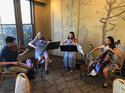 Delightful background music provided by the Radiant Strings: Terence Mui, Elizabeth Wu, Kaiya Pomeroy-Tso, and Katherine Matsukawa.  Kaiya (viola) is Liz's granddaughter.   They are high school students.