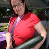 Features at Friday afternoon Lowell Farmers Market. Fauna Rosenbloom of Lowell, with a large zucchini from the Dunbarton Farm booth that she got for $2 and plans to slice and cook. (SUN/Julia Malakie)
