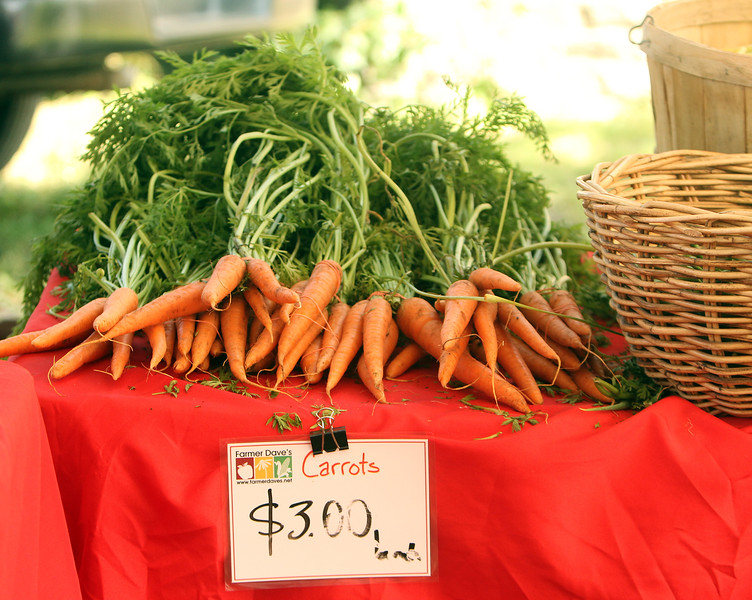 Carrots from Farmer Dave's, at Friday afternoon Lowell Farmers Market. (SUN/Julia Malakie)