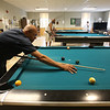 Quilting and pool players at the Lowell Senior Center, which will be a place to stay cool this weekend. Ramon Ramirez of Lowell plays pool. (SUN/Julia Malakie)EMON