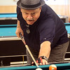 Quilting and pool players at the Lowell Senior Center, which will be a place to stay cool this weekend. Jorge Diaz of Lowell is a regular pool player. (SUN/Julia Malakie)