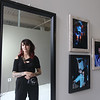 Photographer Kristen Higgins, 25, of Marlboro, reflected in mirror, with some of her concert photos, at the studio she just opened at Western Avenue Studios. Her business is K.H Photography. [no period after the H]  (SUN/Julia Malakie)