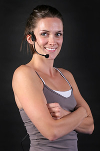 Smiling Fitness Instructor with Arms Folded
