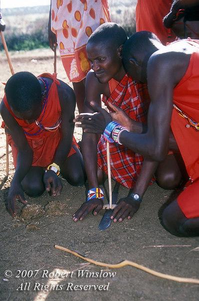 Maasai Men Making Fire, Masai Mara National Reserve, Kenya, Africa