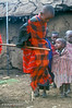 Young Maasai Boy Dancing inside Village (called a Boma or Manyatta), Ngorongoro Crater Area, Tanzania, Africa