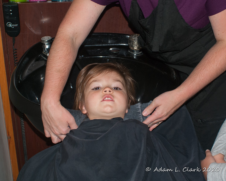 Getting ready to get her hair shampooed before being cut