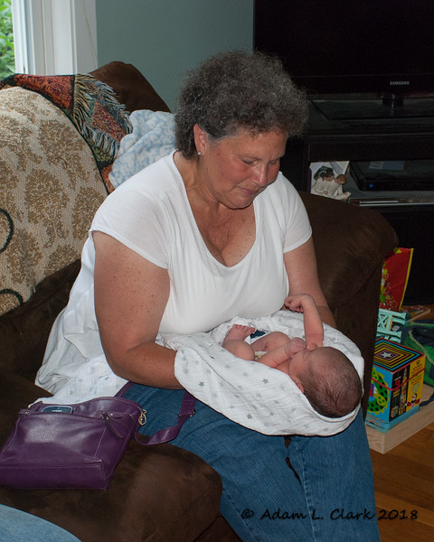 Grammy admiring her new granddaughter