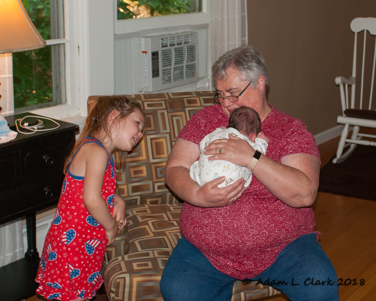 Meme holding Madison for the first time