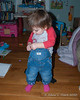2020.02.14<br> Madison trying to put on her own overalls.  She did good until she needed to get the straps over her shoulders and then clip them back on in the front