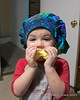 2021.01.26<br> Madison wearing her mother's newly made cap for work while eating an apple