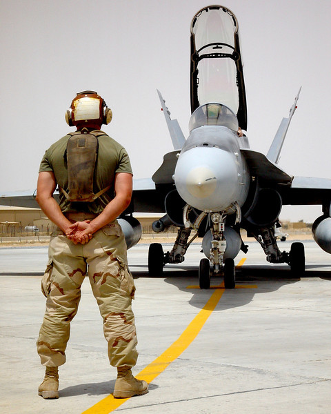 Plane captain prepares to launch a US Marine Corps F/A-18D from Al Jaber airbase, Kuwait.