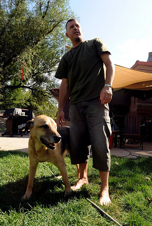 "Brant Clark with Nijo, one of the two dogs he has at his Boulder home.<br /> Major Charles ""Brant"" Clark of Boulder served in Iraq and Afghanistan.<br /> Cliff Grassmick / September 3, 2009"