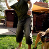 "Major Brant Clark plays with his dogs,  Shamus and Nijo,  in his backyard in Boulder.<br /> Major Charles ""Brant"" Clark of Boulder served in Iraq and Afghanistan.<br /> Cliff Grassmick / September 3, 2009"