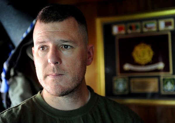 """Major Charles """"Brant"""" Clark of Boulder served in Iraq and Afghanistan. A plaque with his battalion patches is in the background.<br /> Cliff Grassmick / September 3, 2009"""