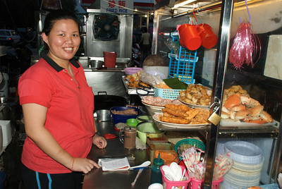 Penang is a city of great food served from tens of thousands of food carts. No need to go to an indoor restaurant - just order from a cart, sit at a nearby table, and wait for some amazing inexpensive food to arrive shortly. This woman and her mother made some incredible seafood dishes. Penang, Malaysia