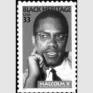The United States Postal Service issued a stamp honoring Malcolm X in 1999. (U.S. Postal Service/AP)  A young Malcolm Little. (The Everett Collection)