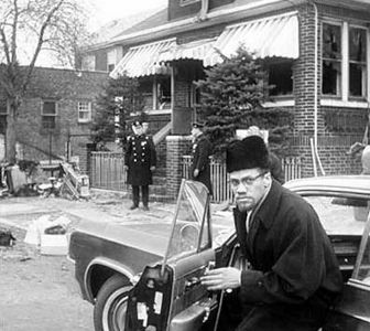 Malcolm X, returns home after his house is bombed February 14, 1965.
