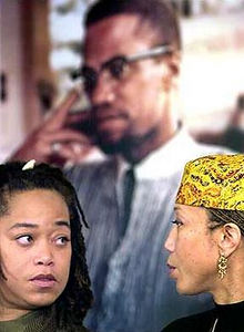 Malaak Shabazz, left, talks with her sister Attallah Shabazz during a press conference at the New York Public Library's  Schomburg Center for Research in Black Culture in Harlem Jan. 7, 2002. The Shabazz family has placed a collection of  Malcolm X's diaries, photos, letters, and other materials on long term loan with the center. (Bebeto Matthews, AP)